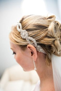 Delicately swept updo for bride with embellished, jewelled headband and veil.