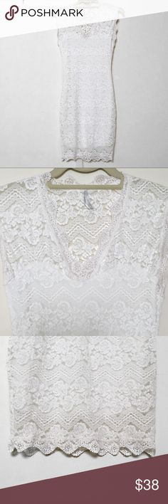 "'Petals' white lace dress Yes! Wear white post-labour day! Pixie Market - true white! / top layer floral embroidery & on semi-sheer cap sleeves / that neckline!/ flattering / accessorise! / perfect condition / NWOT / stretchy - measurements are correct but best suits a S (even if ya gots dem hips n tits or whatever body type cuz like no bodies or body's r the same duh + not restricting or too tight / Measurements (flat): Bust 13"" Waist 11"" Hips 13"" (Would fit 36+ bust and hips + easily 28""…"