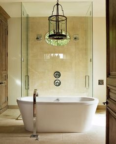 Freestanding tub in front of glass shower. It even has a window like ours! Perfect basement bathroom suite.