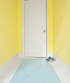 If you don't want the hassle of cleaning a runner in your hallway, paint one on the floor instead.