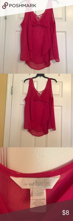 "Pink chiffon sleeveless bow Blouse Sleeveless. Scoop neck. Bow front. Does not come with lining or slip. No flaws. Bust measures 40"". Total length measures 25"". From a pet free and smoke free home. Charming Charlie Tops Blouses"