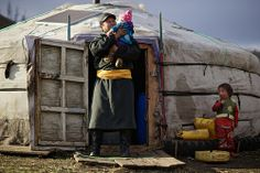 Mongolian man with his baby, Tov aimag, Mongolia Mongolia: the Bradt Guide; www.bradtguides.com