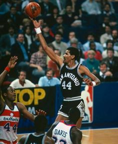 The Iceman George Gervin lets a finger roll loose over the Bullets' Rick Mahorn and Charles Davis in D.C.
