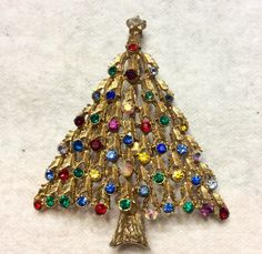 A personal favorite from my Etsy shop https://www.etsy.com/listing/261731620/vintage-1940s-rhinestone-christmas-tree