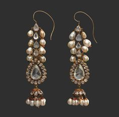 Diamond earrings and pearl supports, late 18th century. India, Deccan, Hyderabad. Islamic. Diamond, pearls, gold, emeralds, and enamel. Private Collection, New York