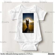 Shop Surfer silhouette during sunrise baby bodysuit created by JFJPhoto. Consumer Products, Basic Colors, Baby Bodysuit, Cotton Tee, Sensitive Skin, Sunrise, Infant, Silhouette, Tees