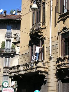 Cleaning a window in Milan
