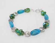 Sharing @trusk4u Calypso Blue Green Lamp Work Beads with Antiqued Pewter Clamshells Bracelet