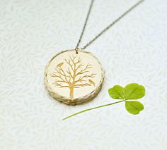 Wood Laser cut Pendant with engraved autumn tree and the edge of the twine. $13.00, via Etsy.