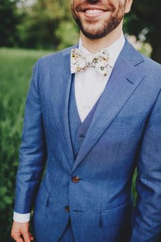 Sharp looking groom. | Floral tie, blue suit | Image by Matt Lien