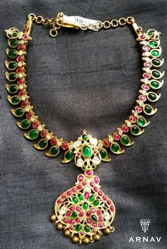 Beautiful mango mala necklace in green stones and burma stones with small locket in peacock pattern.<br>The green stones are designed in mango motifs and locket has gold balls hangings. 18 January 2018