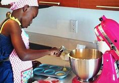 Image: Taylor Moxey baking in her parents' kitchen in Miami (Courtesy of the Moxley family)