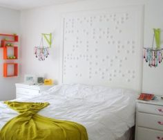 headboard...  It is Braille. You can learn how to write Braille online). Cut styrofoam balls in halves and tape them to the wall to write.... It easy, fun and costs less than ten dollars.