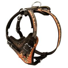 This Leather K9 Harness with Flames is manufactured of quality 100% full grain genuine leather, and hand-painted to resemble flames. Heavy felt padding is attached to the chest plate and neck straps to prevent any dog irritation. This Wire leather harness with flames is available in black leather, with four harness size options to choose from. http://www.k9dogequipment.com/Leather-K9-Harness-with-Flames-p/fdt-lk9h-flames.htm