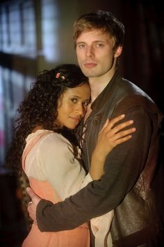 {Angel Coulby & Bradley James as Arthur & Gwen on Merlin}