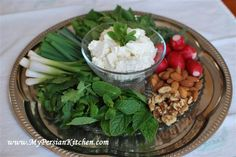 Sabzi (Persian herbs) and feta. Colbeh's version is mint, basil, cilantro, and radish. Serve with walnuts and pita bread.