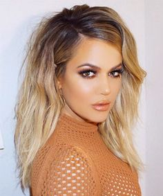 Whether she's rocking short or long hair, brunette or blonde locks, Khloe Kardashian's hair fills us with some serious envy