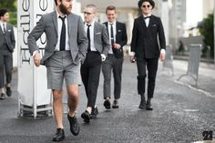 Men wearing grey suits in France