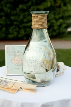 Instead of a guest book, have your guests write a brief message on a piece of parchment and place it in a unique glass container.  You can use is as special decor in your new home, as well as enjoy your friends' sentiments over and over again.