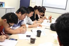 These diploma students concentrate so well!