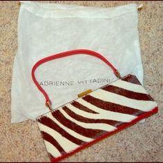 "I just added this to my closet on Poshmark: Adrienne Vittadini Zebra Print Clutch Purse. Price: $100 Size: 8-1/2"" X 3-1/2"""