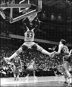 "Darryl Dawkins is a retired American professional basketball player, most noted for his days with the NBA's Philadelphia 76ers. He was nicknamed ""Chocolate Thunder"" for his powerful dunks, which notably led to the NBA adopting breakaway rims due to him shattering the backboard on two occasions in 1979."