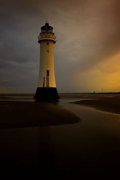 Lighthouse Sunset by andy, via Flickr