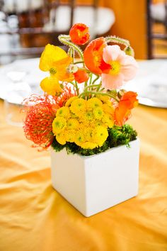 A bright orange and yellow centerpiece that's modern and perfect for fall! {Cory Ryan Photography}