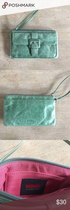 HOBO international Seafoam green leather wristlet This was a Posh purchase and I just have never used. It fits my IPhone 7 with care but I put a pop-socket on it and it's snug for the front pouch which is what i ended it for. Color looks more like first pics, last 3 pics are taken with overhead light at night. Only wear I can tell is a little rub on front buckle- see pic . 3 compartments- large one had cc slots and a side slit. Just trying to make back my money HOBO Bags Clutches & Wristlets