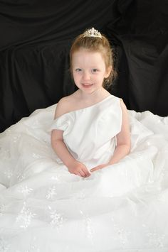 One of my little girls in my wedding dress to display at her wedding some day!