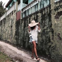 Krystal Bick exploring St Lucia in her Heidi Klein Manda Island Oversized Tunic, Wide Brim Hat and Sandals
