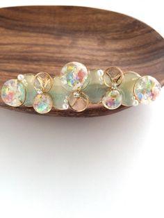 [再販]雨上がりの虹と空のバレッタ|ヘアアクセサリー|PIKARA|ハンドメイド通販・販売のCreema Plastic Resin, Uv Resin, Resin Art, Resin Crafts, Handmade Accessories, Resin Jewelry, Beading Patterns, Turquoise Bracelet, Stud Earrings