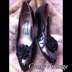 Black patent leather bow toe 80's pumps. Vintage 80's pumps. Black patent leather. Made in USA. Only issue I could find is leather on heels near sole. They have like a bump or ridge. I think they were made that way. Two inch heels and bow clips are removable. vintage easy spirit Shoes Heels