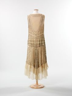Evening dress Date: 1928–30 Culture: American Medium: silk, rhinestones Dimensions: Length at CB: 48 in. (121.9 cm) Credit Line: Brooklyn Museum Costume Collection at The Metropolitan Museum of Art, Gift of the Brooklyn Museum, 2009; Gift of Mrs. J. Francis Warshaw, 1957 Accession Number: 2009.300.1248