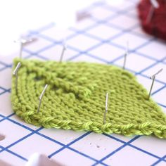 Blocking knitted embellishment is helpful to allow them to lie flat. How to Knit a Leaf with an Easy, Free Knitting Pattern + Video Tutorial by Studio Knit. #StudioKnit Knitting Patterns Free, Free Knitting, Thanksgiving Diy, Learn How To Knit, Knitting Supplies, Leaf Shapes, Fall Decor, Knit Crochet, Crochet Earrings
