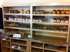 Custom built oak cabinet display, designed for inserting cooling racks for product to cool directly on the shelves.