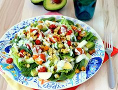Roasted corn and tomato summer salad topped with a lemon basil yogurt dressing. Super colorful and makes a great presentation if you're having guests over.