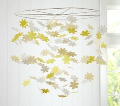 Daisy Paper Mobile-- PB Kids wish I had hung one of these over our changing table--maybe then our kids would have found changing more pleasant Best Baby Mobile, Paper Mobile, Hanging Mobile, Paper Chandelier, Flower Mobile, Wind Sculptures, Yellow Daisies, Girl Nursery, Girl Room