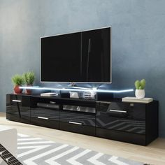 Orren Ellis Casares Cabinet/Enclosed Storage TV Stand for TVs up to 65 inches Colour: Black Modern Contemporary Living Room, Living Room Modern, Living Room Storage, Living Room Tv, Tv Stand Decor, Black Tv Stand, 3 Piece Living Room Set, Modern Tv Units, Decoration