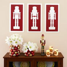 Painted and stenciled Nutcracker wall art above a decorated hall table or mantle - DIY Christmas and holiday decorations - Styled by Lowe's Creative Ideas - Royal Design Studio stencils