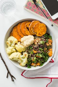 Black bean and quinoa salad with sweet potatoes and cauliflower - a feel-good lunch bowl