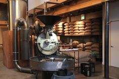 This is sight glass coffee. In San Francisco. Probat roaster. And this shop takes people on a journey from crop to cup. Gallery style.