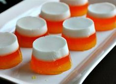Candycorn Jello Shots  Ingredients      1 envelope unflavored gelatin2 1/2 cup water, divided1 cup unsweetened coconut milk, divided1/4 cup sugar1 1/2 cup vanilla vodka, divided3 ounce packet of orange gelatin1 cup water3 ounce package of pineapple gelatin Yellow food coloring
