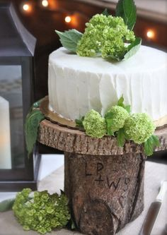 Love the rustic wood cake stand with the couple's initials carved into it.