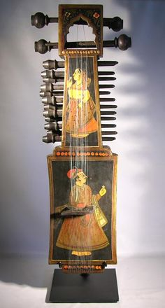 Custom display stand for an antique Sarangi (stringed instrument) from India.