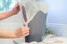 Keep a trash bag in place with an upside down command hook.