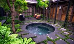 stone backyard hot tub