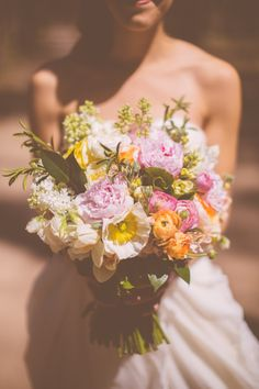 huge oversized bouquet of peonies, poppies, ranunculus, and more in white, pink, yellow and tangerine