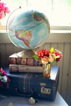 Vintage globe, books and suitcase.