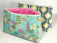 Zip-Up DIY Cosmetics Bag | AllFreeSewing.com @Annette Rushing  super cute!  Wish I could make these!